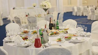 Beautifully decorated wedding tables full of tasty food