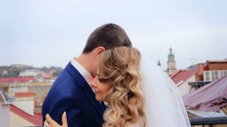 Bride and groom at wedding dance on the roof overlooking the city shot in slow motion  close up