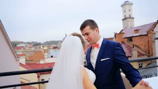 Bride and groom at wedding dancing together on the roof overlooking the city shot in slow motion  close up