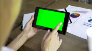 Business woman using digital tablet pc with green screen for internet and email, close-up