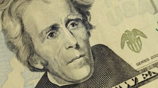 Cash money background. Andrew Jackson portrait on 20 US dollar bill close up rotation