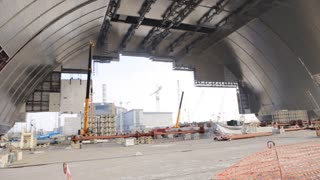 CHERNOBYL, UKRAINE - MAY 11, 2015: Construction of a new safe confinement over the fourth power in the Chernobyl exclusion zone.