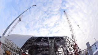 CHERNOBYL, UKRAINE - MAY 24, 2015: Workers assemble cage confinement. Construction of a new safe confinement over the fourth power in the Chernobyl exclusion zone.