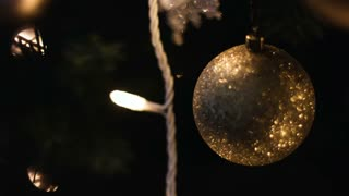 Close-up of gold decorative bauble hanged on Christmas tree