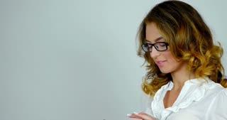 Close-up portrait  cheerful girl talk on cellphone  Caucasian female model on white background in studio.