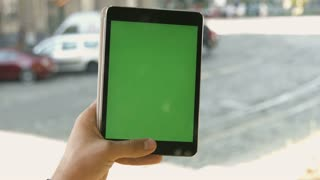 Close Up Young Man Holding Vertical Tablet With Green Screen