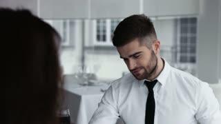 Closeup portrait of mature man at restaurant smiling
