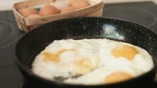 Common for a breakfast preparation of fried eggs on a cast-iron frying pan.
