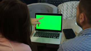 computer (notebook) green screen - woman and man works on computer in cafe