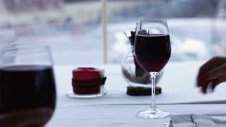 Couple toasting wine glasses close-up