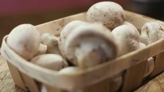 Cultivated mushrooms in a basket closeup