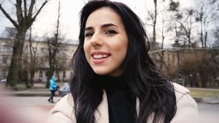 Cute happy woman relaxing outdoors.