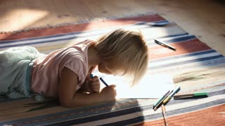 Cute little girl on the floor thinking on a drawing concept