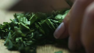 Cutting parsley with a knife closeup