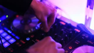 DJ playing sound closeup at nightclub