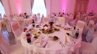 Elegant table set for wedding day made by professional service workers in the fancy restaurant.