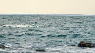 Empty beach , big waves breaking on rocks. Amazing view.