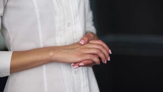 Empty open female palm gesture, woman in white shirt close-up