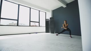 Fitness woman doing lunges exercises for glute and leg muscle workout training core muscles, balance, cardio and stability. Active girl doing front forward one leg step lunge exercise