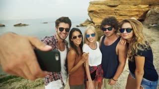 Five friends taking selfies .