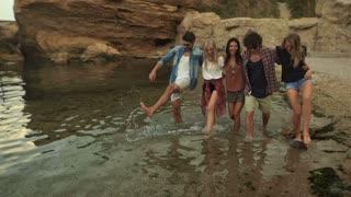 Friends walking on the beach.