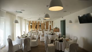Gorgeous wedding chair and table setting for fine dining at restaurant with modern interior
