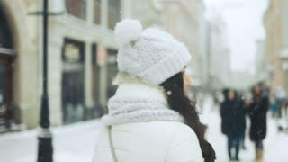 happiness, winter holidays, christmas, beverages and people concept - Attractive beautiful lady posing and flirting on camera over snowy city background