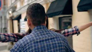 Happy couple hugging in the city, slow motion, shot at 60fps