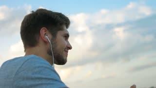Happy man listening to music.