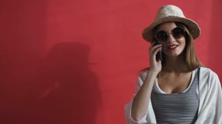 In studio a young girl talking on a mobile phone. Business and communications