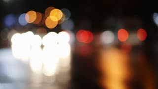 Lighting street in a big city, bokeh from cars light on the road.