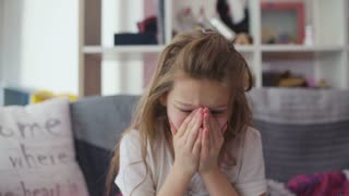 Little girl coughing at home
