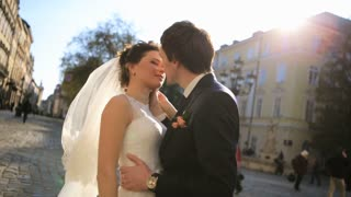 Lovely wedding couple kissing in the city  shot in slow motion  close up