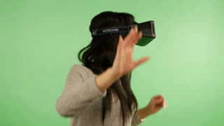 LVIV, Ukraine - NOVEMBER 26, 2015: Girl in virtual reality is smilling and it makes him laughing. Green screen