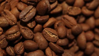 Macro dolly shot of coffee beans. Find similar clips in our portfolio.
