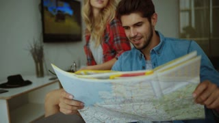 Man and woman taking a look on a map.