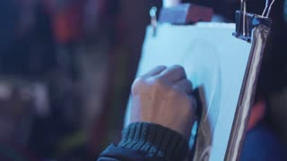 Man drawing on the paper on street