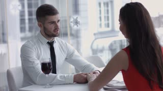 Man produces ring and asks woman to marry him - she accepts,  Marriage Proposal - A man gives a ring to a woman proposing marriage. She surprises and smiles.   Indoors, restaurant, romantic dinner