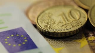 Many euro banknotes and coins, closeup shot