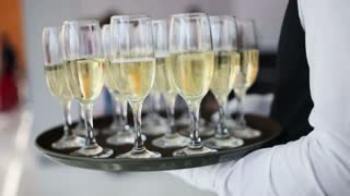 Many glasses of champagne on the table