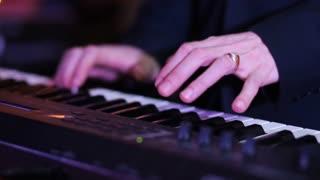 Playing keyboard closeup in slow motion
