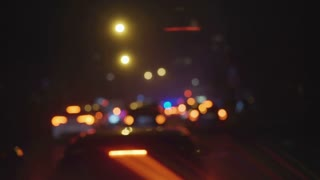 Road traffic in city at night. Shot is made with defocus.