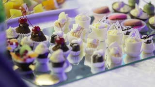 Selection of decorative desserts on a buffet table at a catered luxury event or celebration