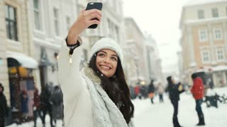 Smartphone woman taking selfie self portrait photo happiness, winter holidays, christmas, beverages and people concept