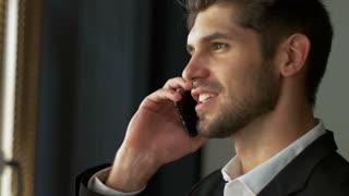 Successful businessman using his mobile phone.