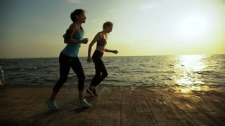 Two active friends training sport near the sea.