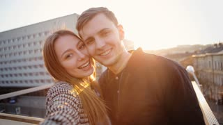 Two adorable people in love feeling happy to be together and taking selfies to remember this time forever .
