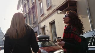 Two women walking in the city, steadicam shot
