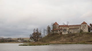 Beautiful old castle on a hill near lake, river