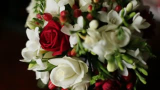 Close up of beautiful wedding bouquet with red and white roses. Fresh wedding flower bouquet. Bridal bouquet